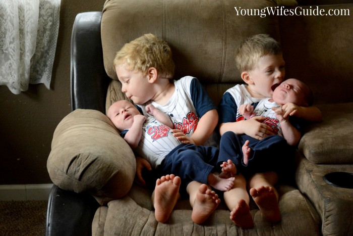 Kissing their baby brothers